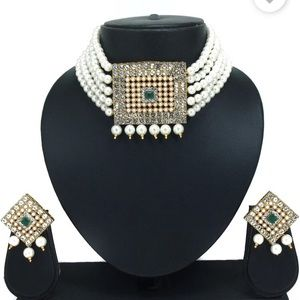 Pearl necklace set with green kundan.